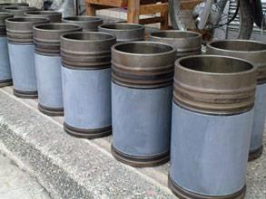 Cylinder liners restored and coated for erosion and corrosion protection